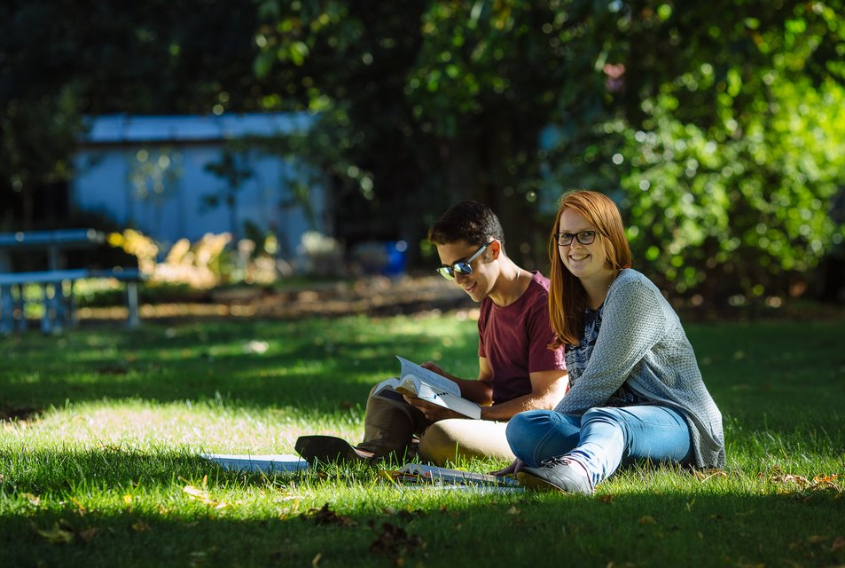 Two residents studying on Aldridge Lawn